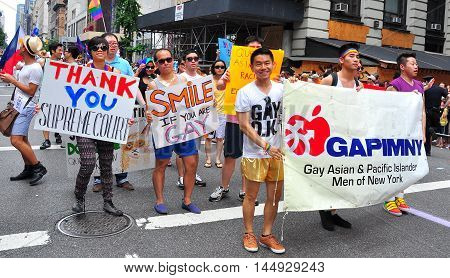 New York City - June 29 2013: Gay Asian & Pacific Islander Men of New York marching in the Gay Pride Parade on Fifth Avenue