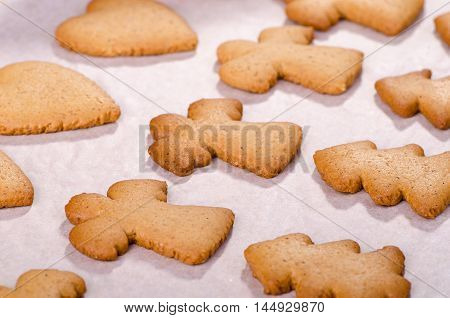 Cooked Christmas gingerbread cookies with ginger on a sheet of parchment