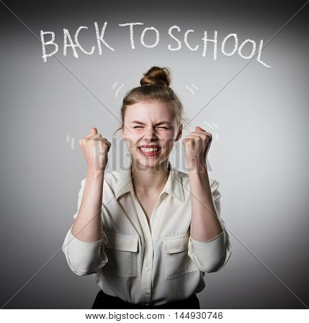 Happy slim woman in white is ready to go back to school. Back to school concept.