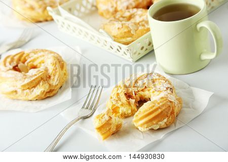Sweet And Tasty Eclairs On A White Background