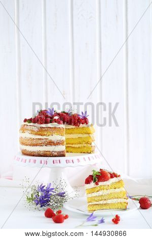 Delicious Biscuit Cake With Berries On Cake Stand