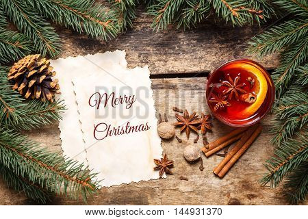 Merry Christmas Card With Mulled Wine On Wood