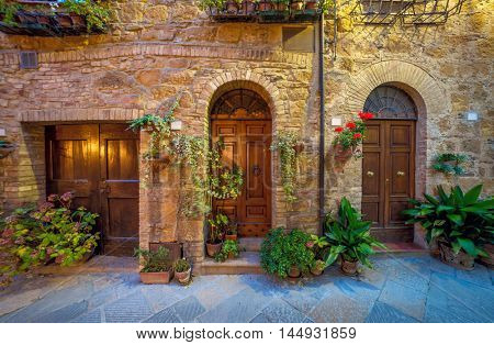 Night view of street in small mediterranean town, old houses, doors and flowers. Beautiful and historical place, Italy, Europe