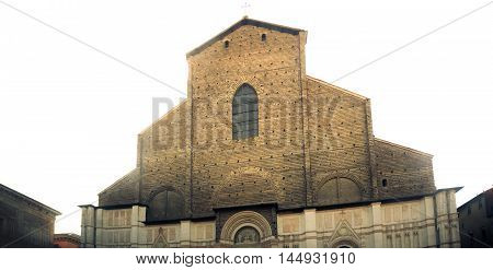 the unfinished facade of San Petronio basilica in Bologna with white light backlighting