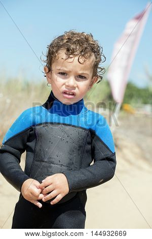 Portrait Of Young Boy By The Beach In Diving Suit