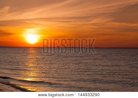 Amazing sunset on the empty beach Cape Cod USA