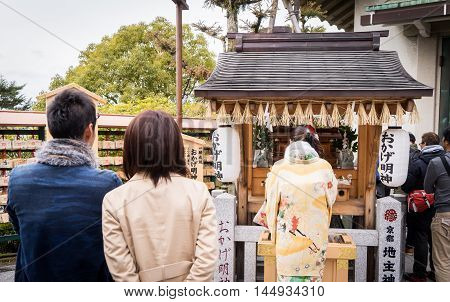 Kyoto, Japan - March 13, 2016: Kyoto on March 13, 2016. Japanese lady is praying in a shrine.