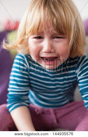 Little Child Crying Sitting