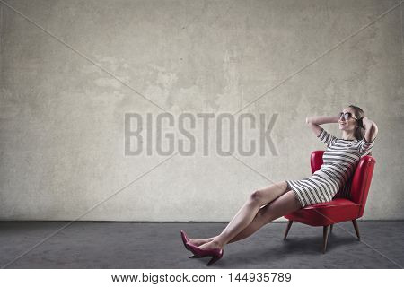Woman relaxing on a red chair