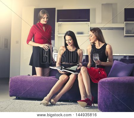 Three beautiful girls relaxing in the living room