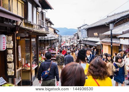 Kyoto, Japan - March 13, 2016: Tourists are traveling in Kyoto traditional shopping street.