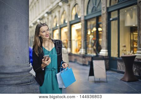 Smiling woman doing shopping