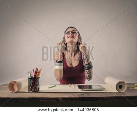 Young woman exulting for her success