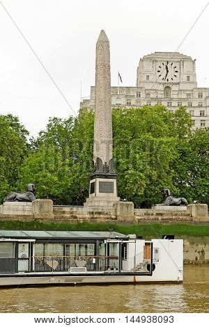 LONDON UK - JULY 8 2016: Cleopatra's Needle in London is one of three similar named Egypian obelisks and is located in the City of Westminster on the Victoria Embankment.