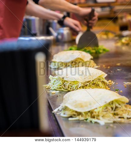 Chef is Cooking Hiroshima authenic Okonomiyaki hot pan