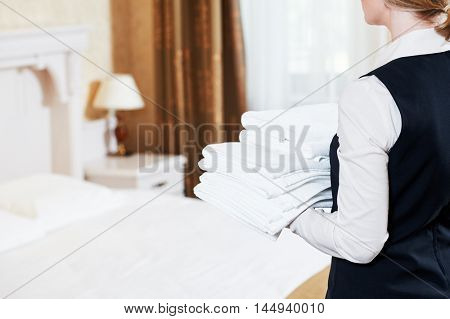 Hotel services. housekeeping maid with linen