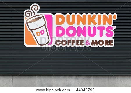 Wasserbillig, Luxembourg - July 24, 2016: Dunkin' Donuts sign on a wall. Dunkin' Donuts is an American global doughnut company and coffeehouse chain.