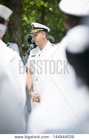 NEW YORK MAY 27 2016: Admiral Phil Davidson, Commander US Fleet Forces Command, speaks to personnel during the re-enlistment and promotion ceremony at the National September 11 Memorial site.