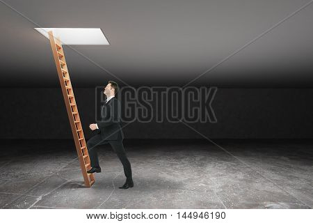 Businessman climbing wooden ladder in dark grey basement leading out to light. Freedom concept. 3D Rendering