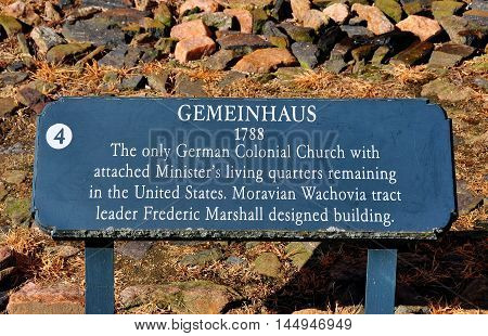 Bethabara North Carolina - April 23 2016: Sign at the 1788 Gemeinhaus Moravian Church with attached minister's house at Bethabara historic settlement *