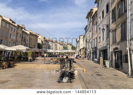 Eople Enjoy The Central Market Place In Aix En Provence