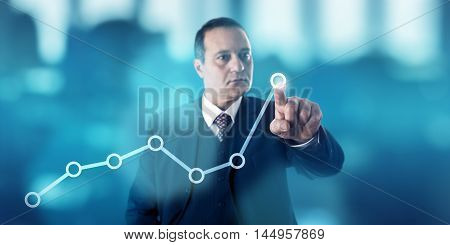 Mature business man is marking a growth trend in a line chart via touch on a virtual screen. Concentrated look confident facial expression. Highly focused and energetic hand gesture. Copy space.