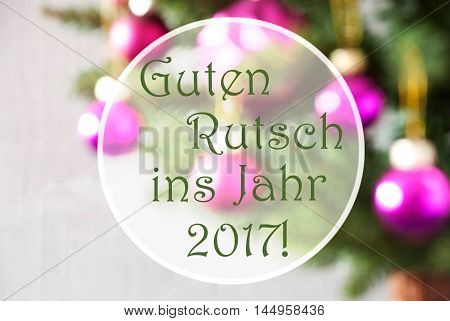 German Text Guten Rutsch Ins Jahr 2017 Means Happy New Year 2017. Blurry Christmas Tree With Rose Quartz Balls. Close Up Or Macro View. Christmas Card For Seasons Greetings.