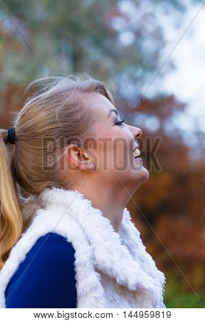 Seasons happiness and outdoors activities. Spending time outdoors on fresh air. Young girl walk outside in autumnal park. Take break from chores and work having fun.