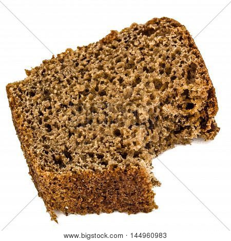Bitten slice of bread made of dark flour isolated on white background