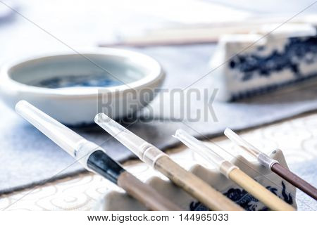chinese brush pens on stone
