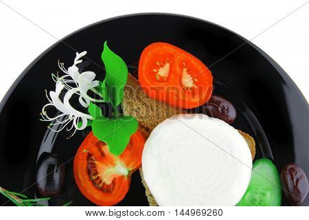 light cheese with vegetables on bread over white