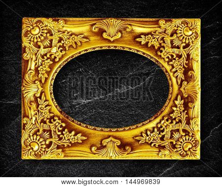gold frame on black slate background .
