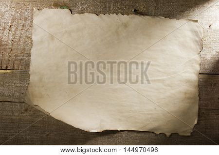 Background old crumpled paper texture on a wooden background