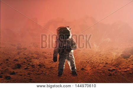 Astronaut walking on Mars. Elements of this image furnished by NASA
