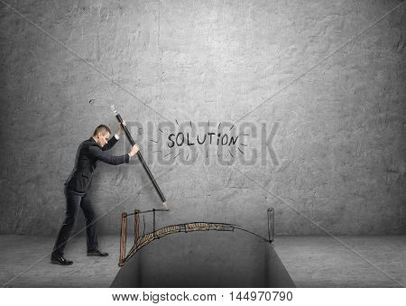 Businessman drawing a bridge over a gap with word 'solution' above it. Solving problems. Troubles and difficulties. Successful management.