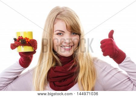 Smiling Girl In Gloves Holding Decorated Cup Of Tea And Showing Thumbs Up, Autumn Decoration