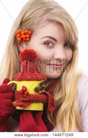 Smiling Girl In Gloves Holding Cup Of Tea With Woolen Scarf And Cap