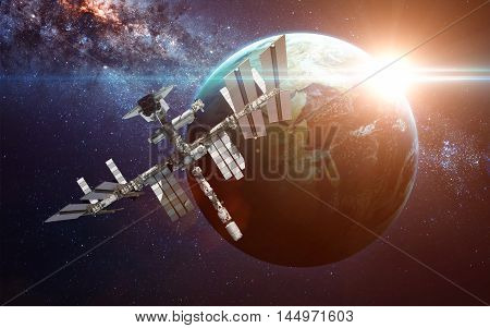 International Space Station over the planet Earth. Elements of this image furnished by NASA