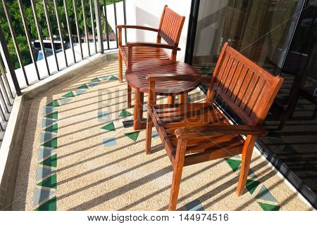 Wooden table and chair set in hotel