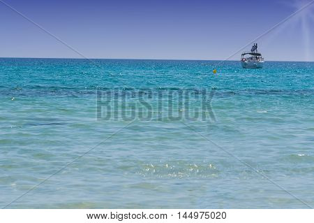 Beautiful seascape with yacht on the blue sea. Place Photo with Copy Space.
