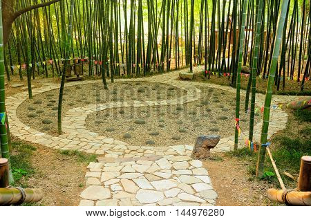 A taoist Ying and yang symbol walkway within a bamboo forest in the Wuxi china three kingdoms attraction in Jiangsu province.