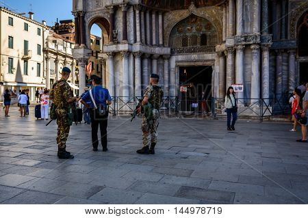 Venice Italy - August 13 2016: Venice Italy. St. Mark's Square with guarding policemen