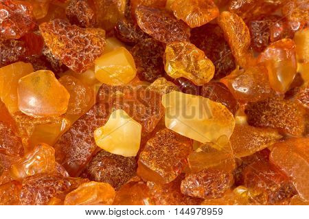 closeup amber stones rectangular lie on a flat surface. for background