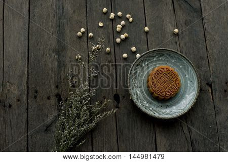 Moon cake with tea on wooden background. Vietnam. China. Mid-autumn festival.