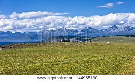 Lakeside Hovsgol, Mongolia, mountain landscape,  the car away