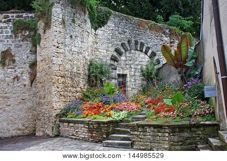 flower display by the city walls in Gray, France