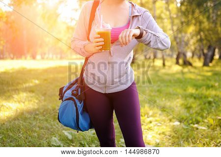 Athletic Woman And Green Smoothies In The Park.