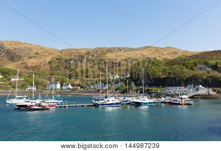 Boats in Mallaig harbour Scottish Highlands Lochaber Scotland UK on the west coast near Isle of Skye in summer with blue sky