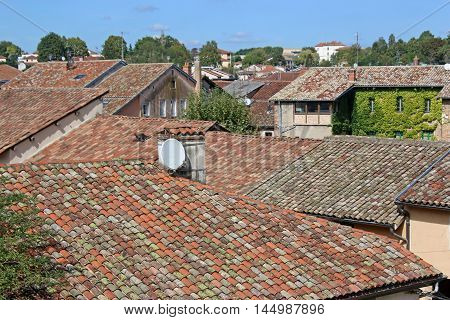 looking across tiled roofs in a French village