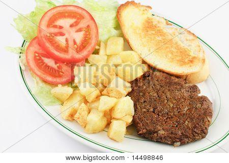 Patatas y carne de la hamburguesa